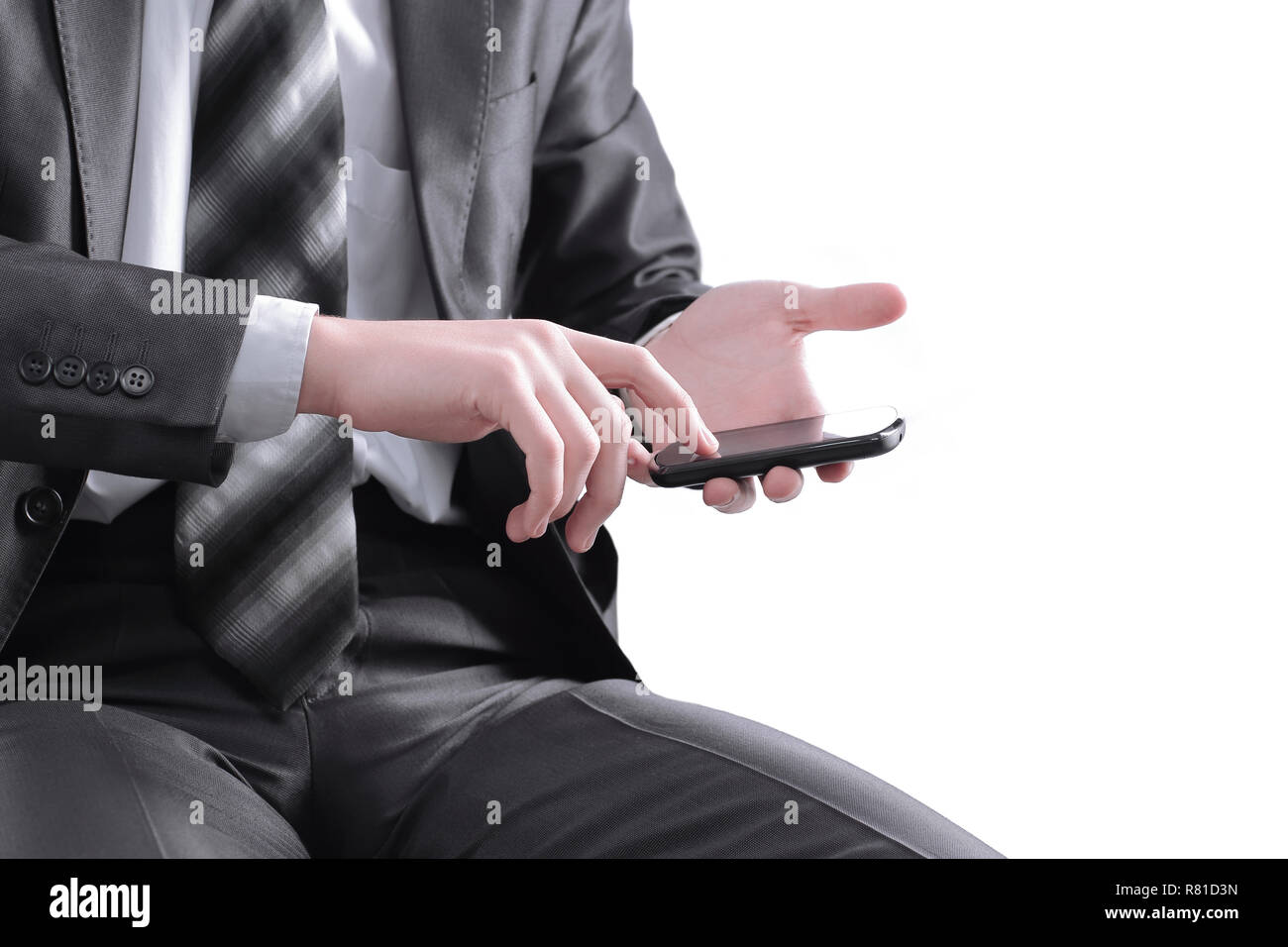 close up. businessman tapping the screen of the mobile phone - Stock Image