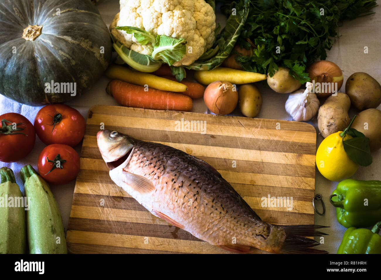 fresh fish and raw vegetables - Stock Image