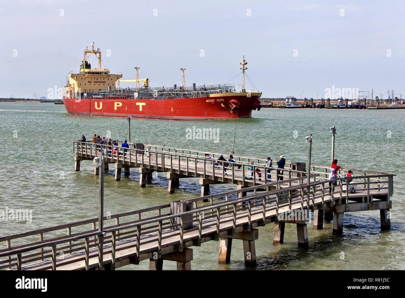 Liquid Bulk Tanker 'Mount Hope', UPT maneuvering Corpus Christi Shipping Channel, passing Roberts Point Park, Port Aransas. - Stock Image
