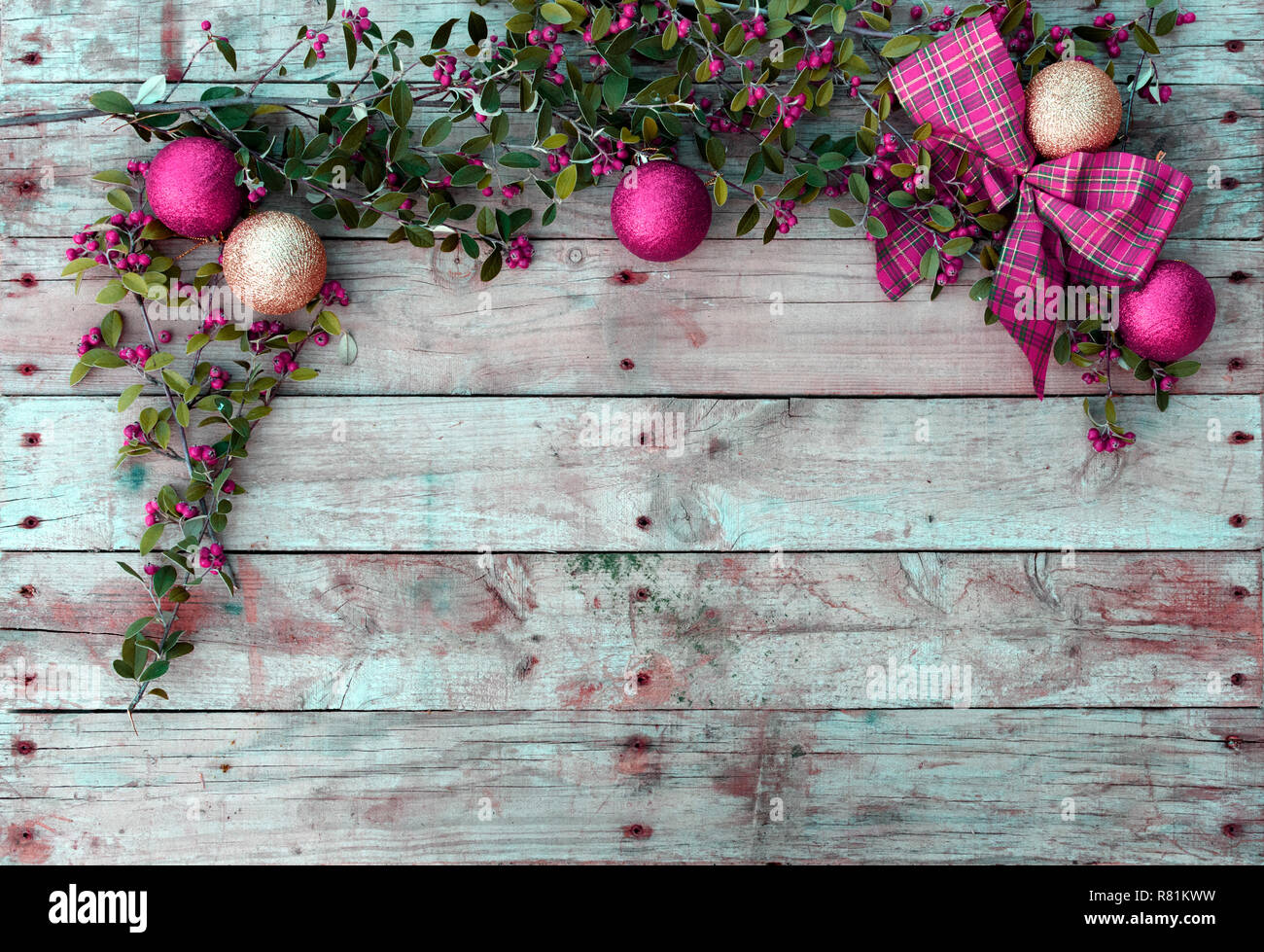 Christmas postcard frame on wooden background. For greeting card. Xmas wallpaper. Red and magenta tones. Christmastime - Stock Image