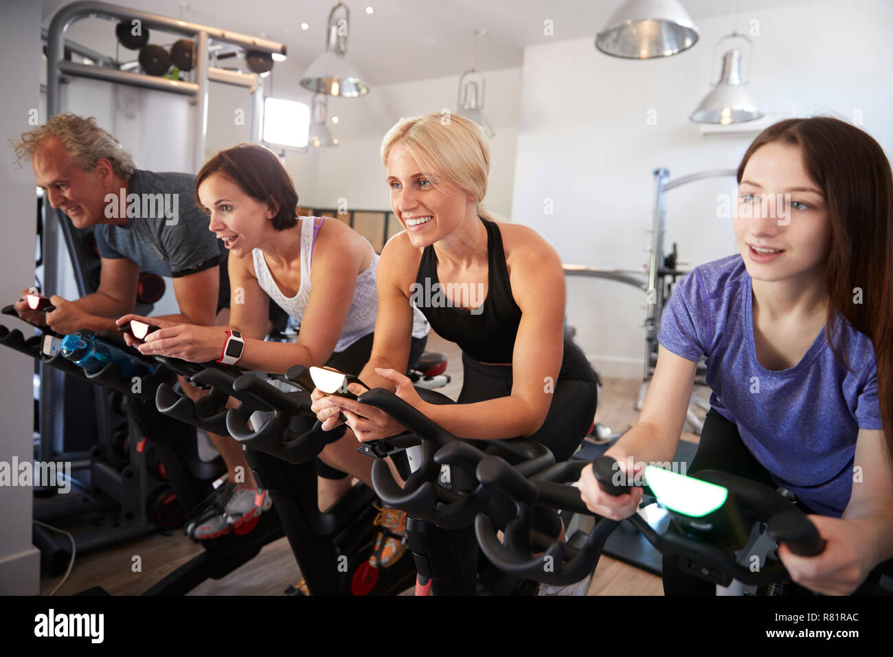 Group Taking Spin Class In Gym Stock Photo