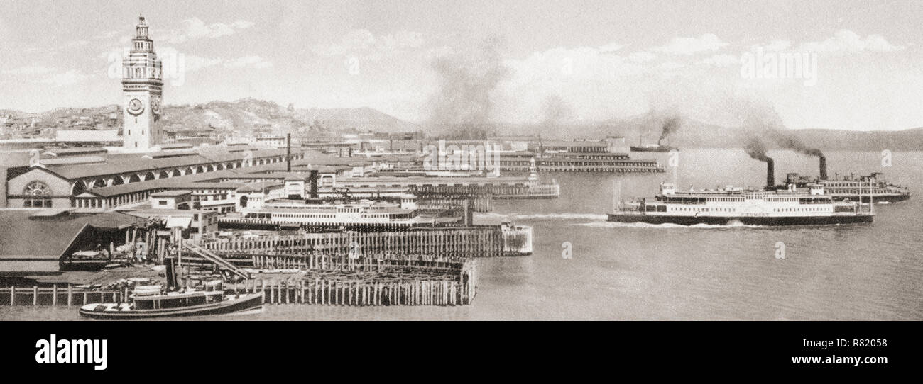 The ferry slips in front of the The San Francisco Ferry Building, The Embarcadero, San Francisco, California, United States of America, c.1915. From Wonderful California, published 1915. - Stock Image