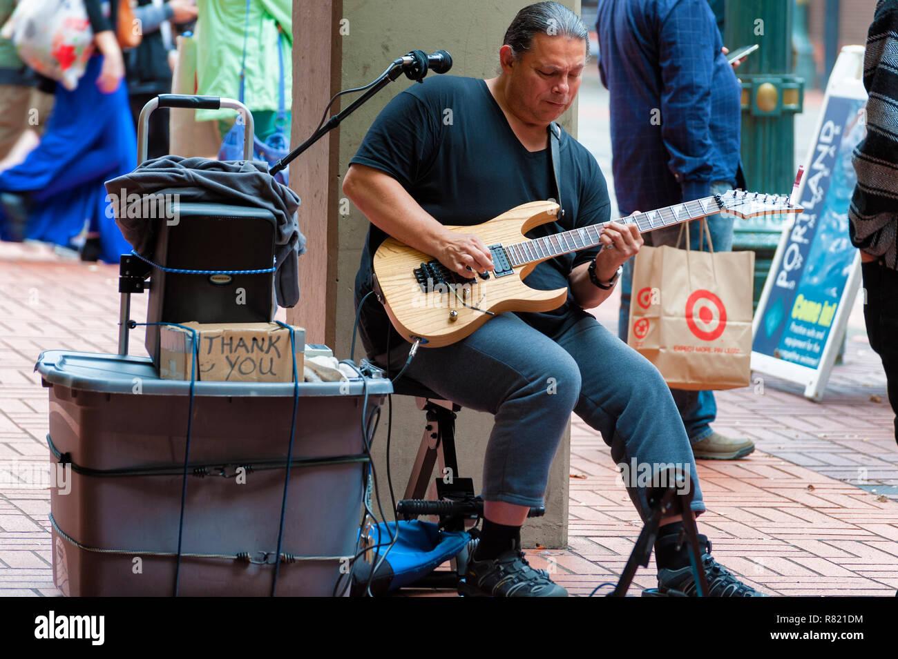 Portland, Oregon,USA - October 8, 2016: A street performer plays an electric guitar in downtown Portland, Oregon Stock Photo