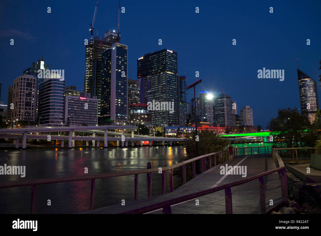 Brisbane city centre and Brisbane River at night from South Bank, Queensland, Australia - Stock Image