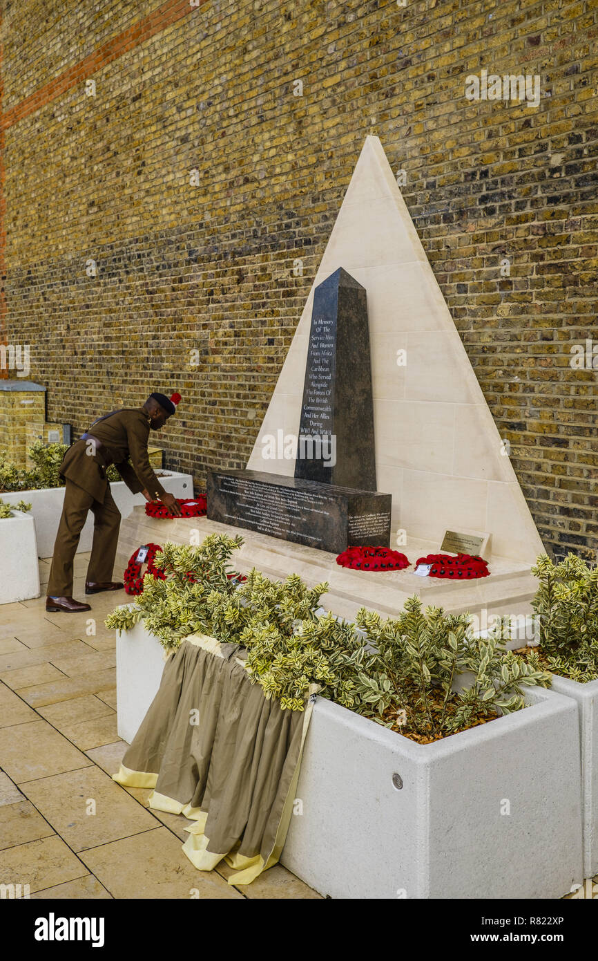 At 11:00, the bugle sounded in Lambeth, near the Stockwell station. With the MP detachment and the London fire fighters, wreaths are laid at the foot of the monument where 574 local men are remembered  At 13:00, on Windrush square, Afro-Caribbean and African solders are remembered  Featuring: Laying the wreath. Where: London, United Kingdom When: 11 Nov 2018 Credit: Alozie/WENN.com - Stock Image