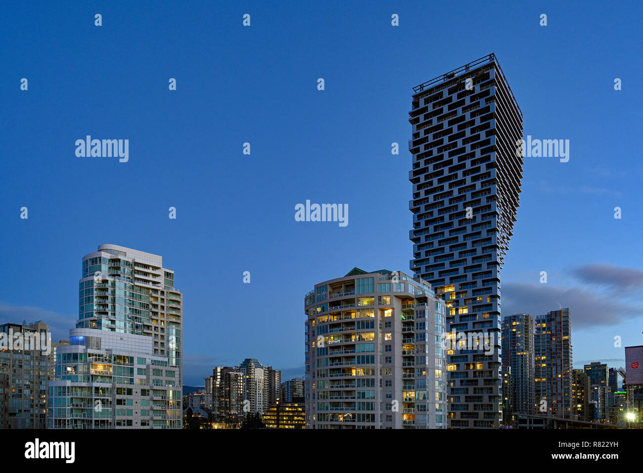 Unusual High rise condo building, Vancouver House,  Bjarke Ingels Group architects, Vancouver, British Columbia, Canada. - Stock Image