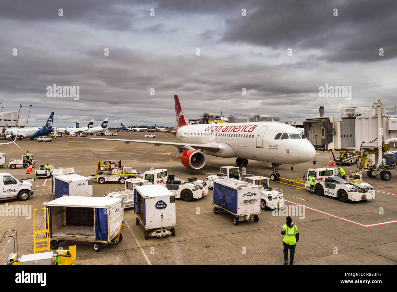 SEATTLE TACOMA AIRPORT, WA, USA - JUNE 2018:  Virgin America Airbus A320 jet with ground equipment in the foreground. A tug is attached to the plane t - Stock Image