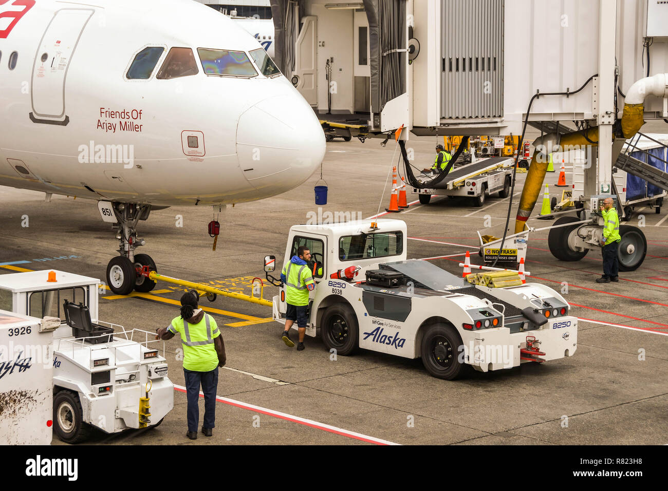 SEATTLE TACOMA AIRPORT, WA, USA - JUNE 2018: Close up view of the nose of a Virgin America Airbus A320 jet. A tug is attached to the plane to push it  - Stock Image
