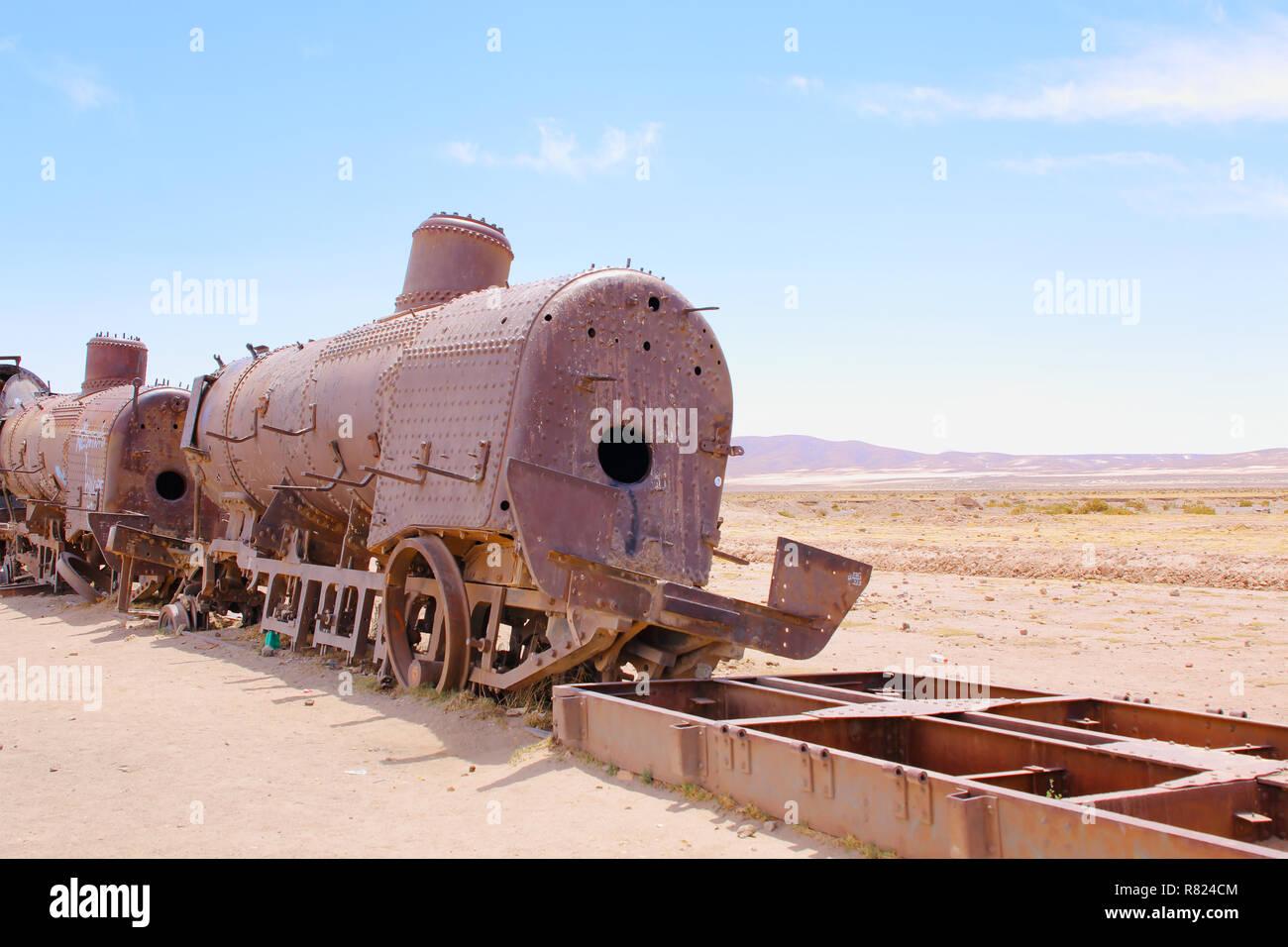Train Cemetery, in Uyuni, Bolivia near the salt flats. Rusty old steam train. Stock Photo