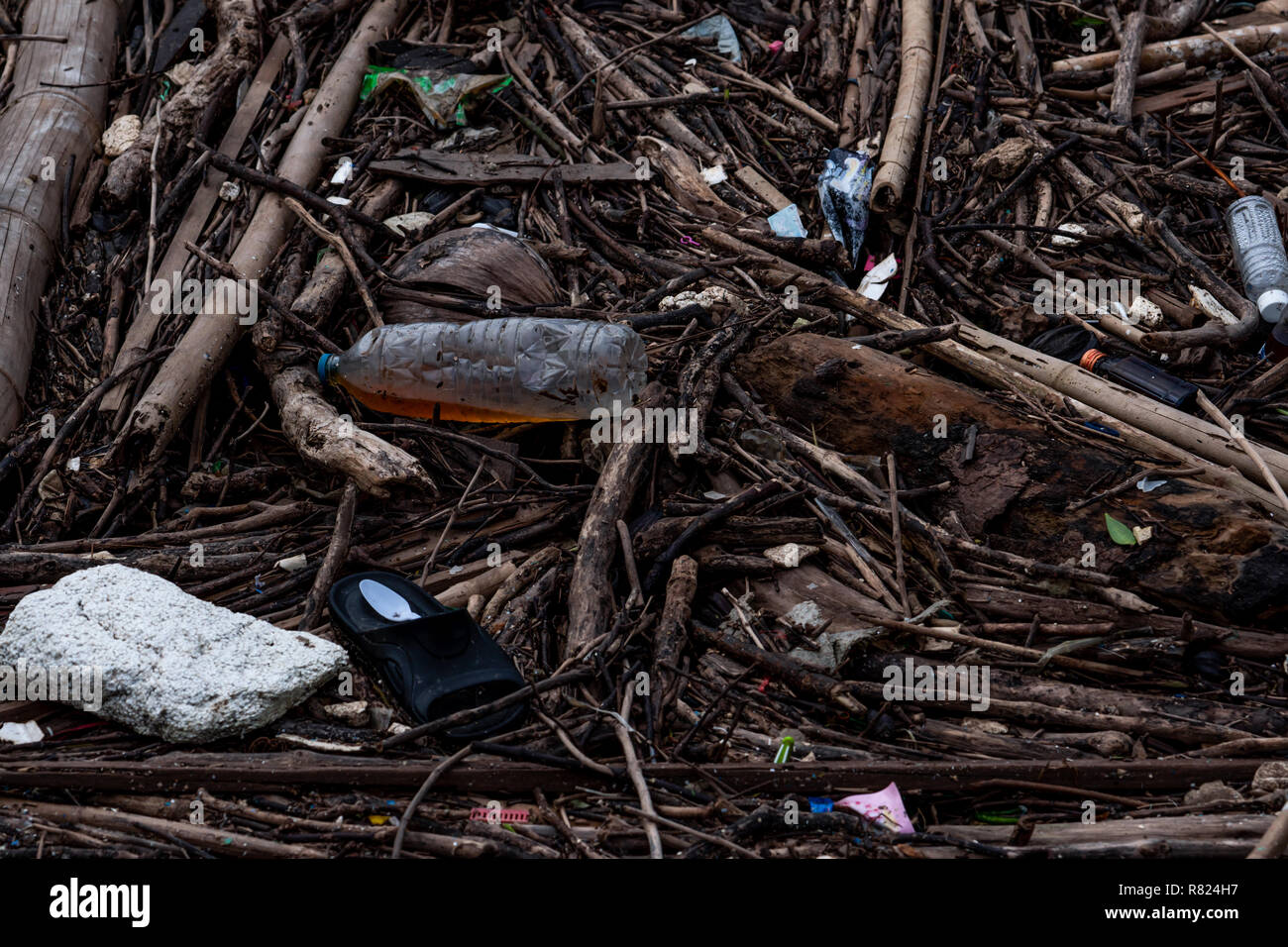 Pile of debris and waste after flood. Waste problem in the environment. Problem of plastic from households. Waste management behavior concept. Househo - Stock Image