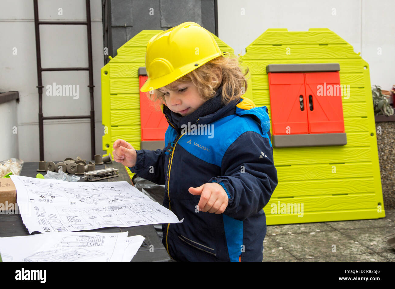 Little Boy 3 Years With Toy Hard Hat Helping To Build A Playhouse