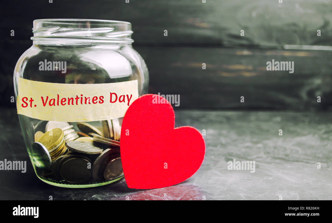 Glass Jar With Money And The Inscription Valentine S Day The Accumulation Of Money For The Holiday Savings On The Purchase Of Gifts For Loved One Stock Photo Alamy