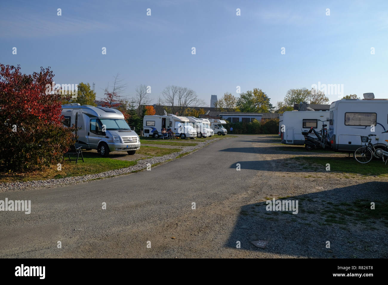 Caravan parking ground or camping place or Campingplatz with caravans or camping trailers in Wismar, Germany during sunny day - Stock Image