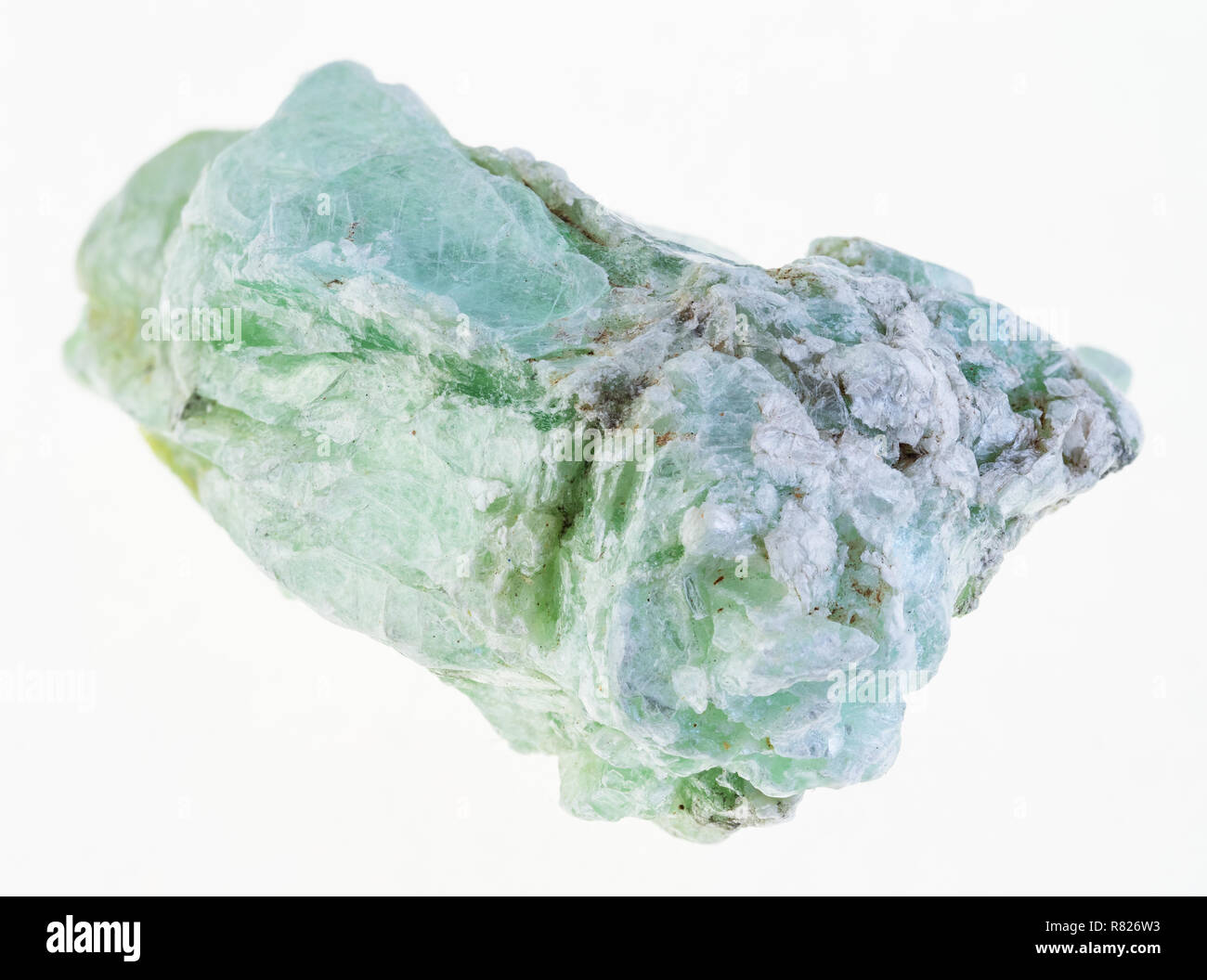 macro photography of natural mineral from geological collection - rough green talc stone on white background - Stock Image