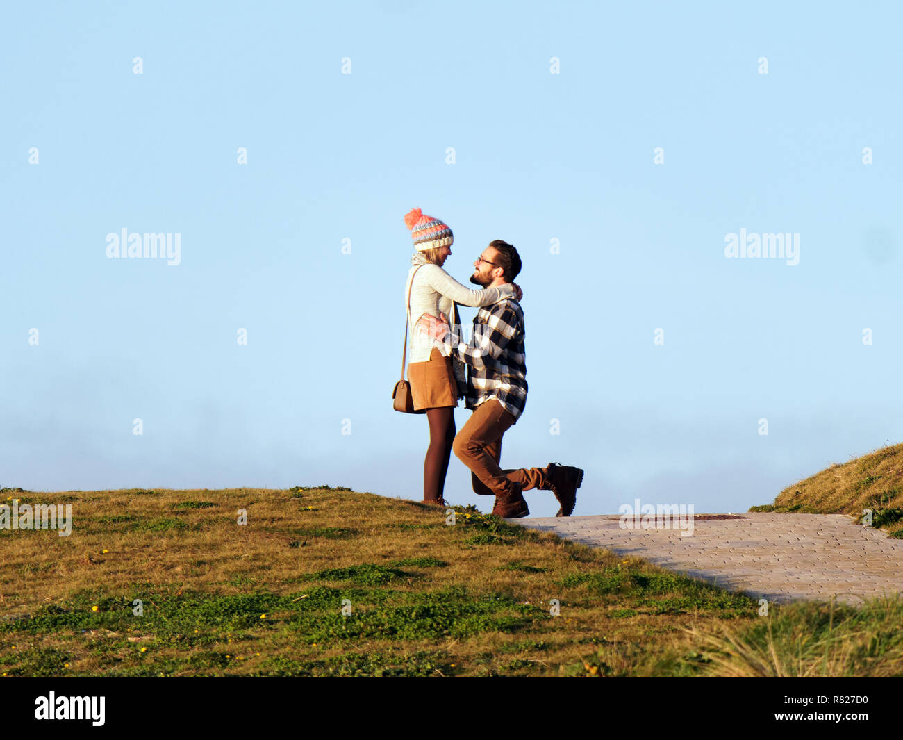 Wedding proposal caught accidentally by photographer. - Stock Image