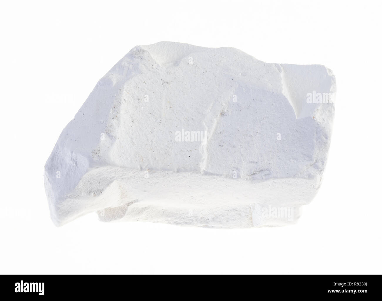 macro photography of natural mineral from geological collection - raw chalk stone on white background - Stock Image
