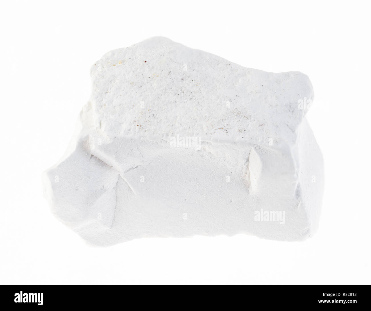 macro photography of natural mineral from geological collection - rough chalk stone on white background - Stock Image