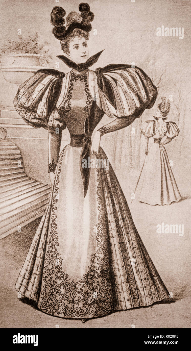 Early 20th Century women's fashion consisted of huge bell skirts. baloon sleeves and high plumed bonnets. - Stock Image