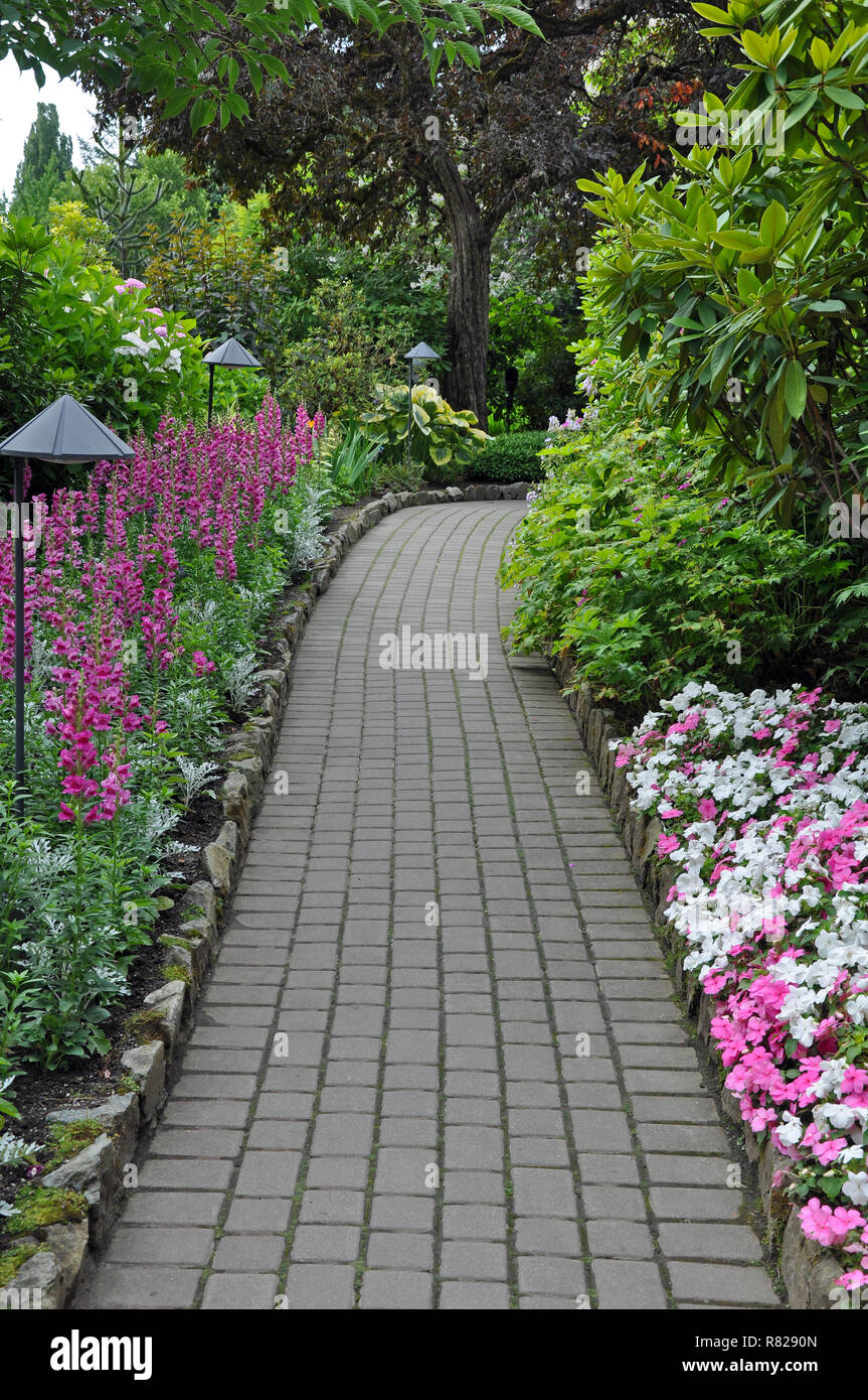 Beautiful spring garden pathway Stock Photo - Alamy