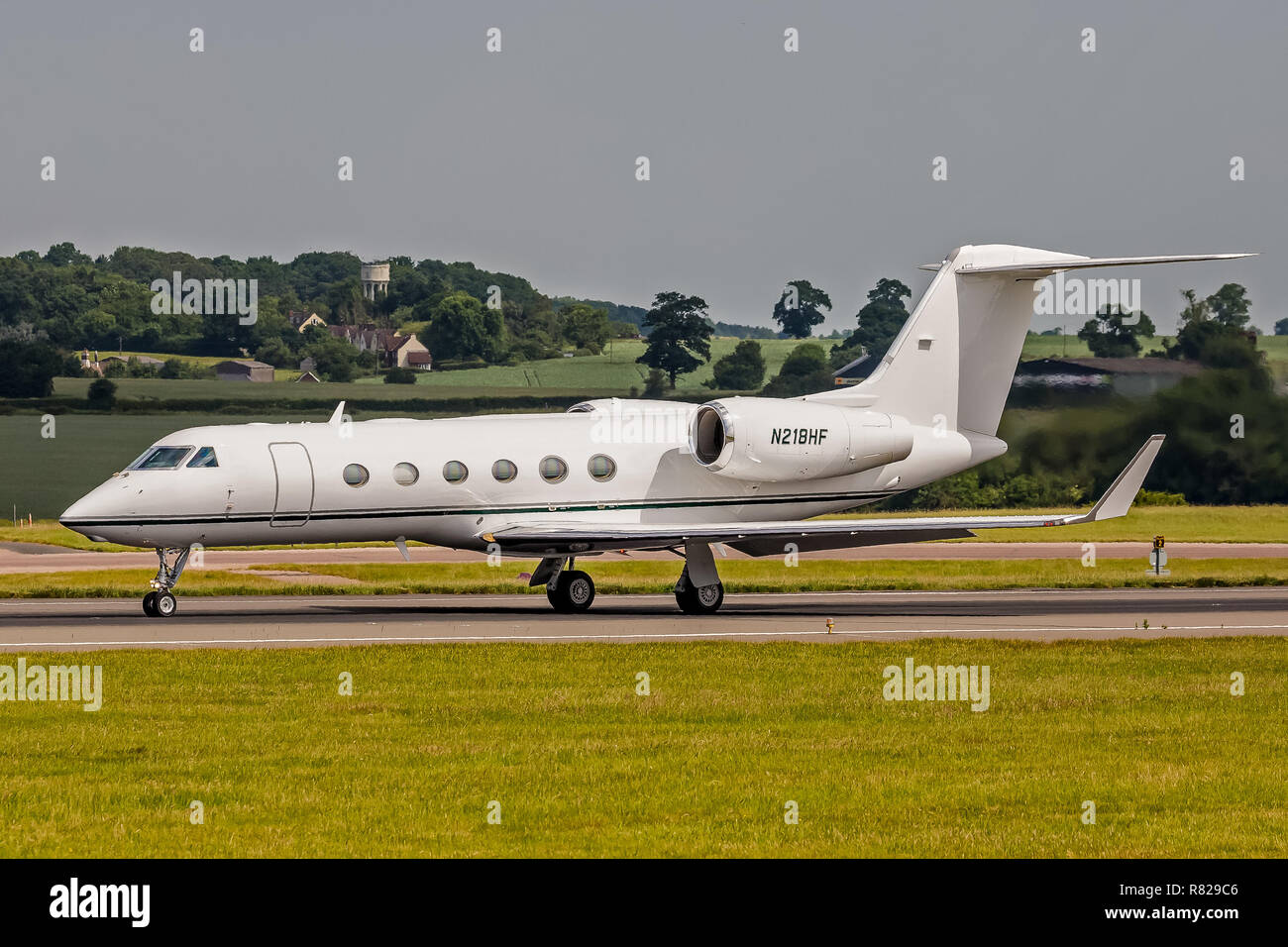 A Gulfstream Aerospace Gulfstream 4 (G450) executive business jet, registration N218HF, at London Luton Airport in England. - Stock Image