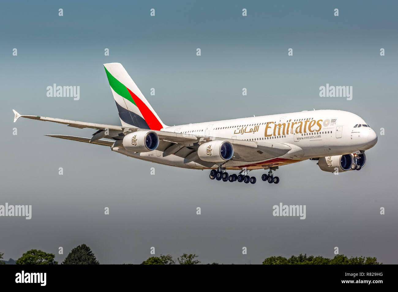 An Emirates Airlines Airbus A380 aircraft, registration A6-EEE, landing at Manchester Airport in England. - Stock Image