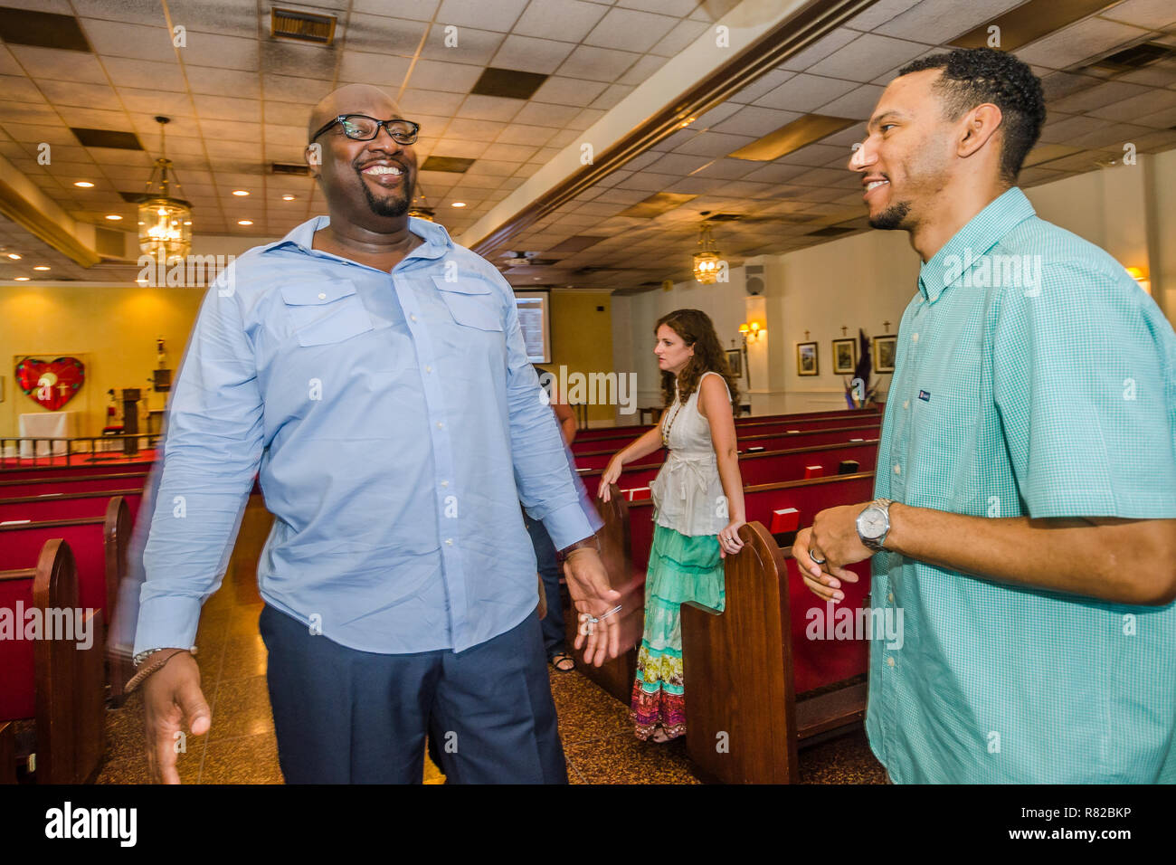 Urban Hope Community Church pastor Alton Hardy talks with church treasurer Dion Watts after the service, July 19, 2015, in Fairfield, Alabama. - Stock Image