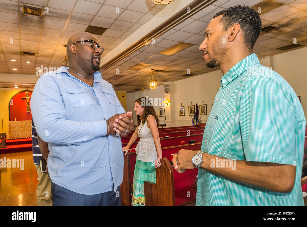 Urban Hope Community Church pastor Alton Hardy talks with church treasurer Dion Watts after the Sunday service, July 19, 2015, in Fairfield, Alabama. - Stock Image