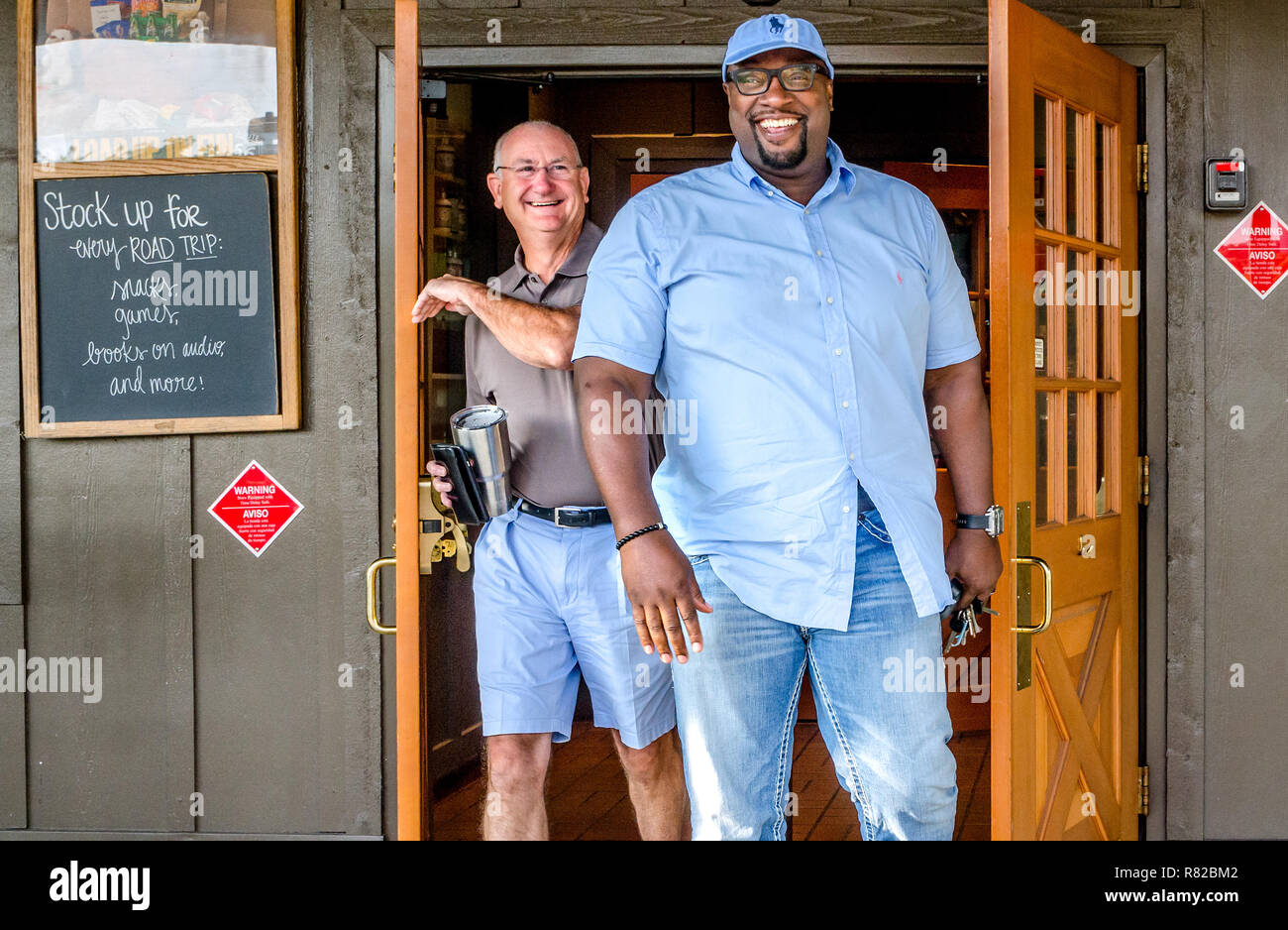 Birmingham pastors Bob Flayhart and Alton Hardy smile as they leave Cracker Barrel in Birmingham, Alabama. They are working to improve race relations. - Stock Image