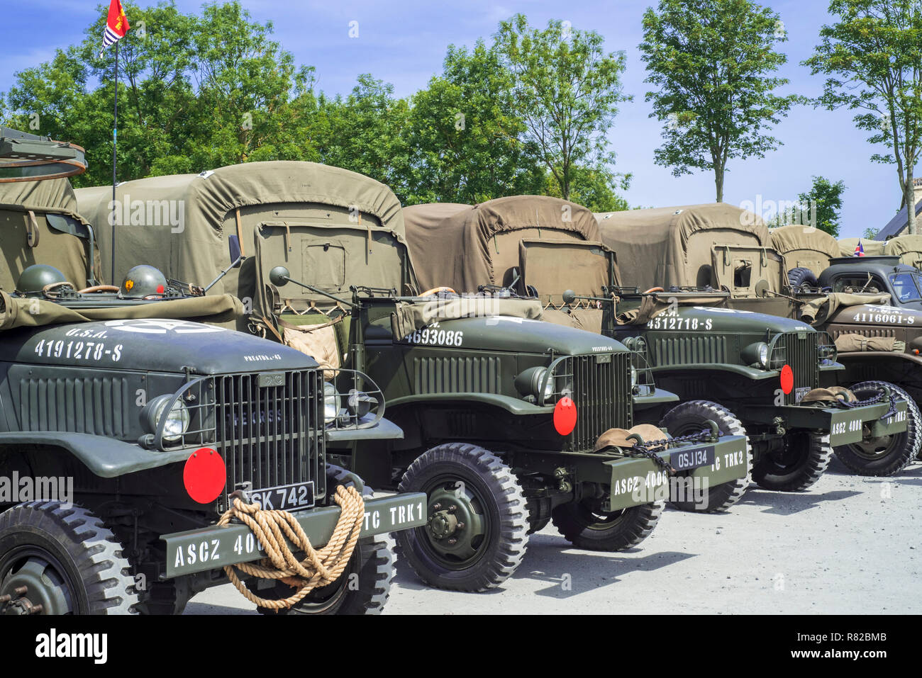 American World War Two GMC CCKW 6x6 US Army cargo trucks, military vehicle also known as Jimmy - Stock Image