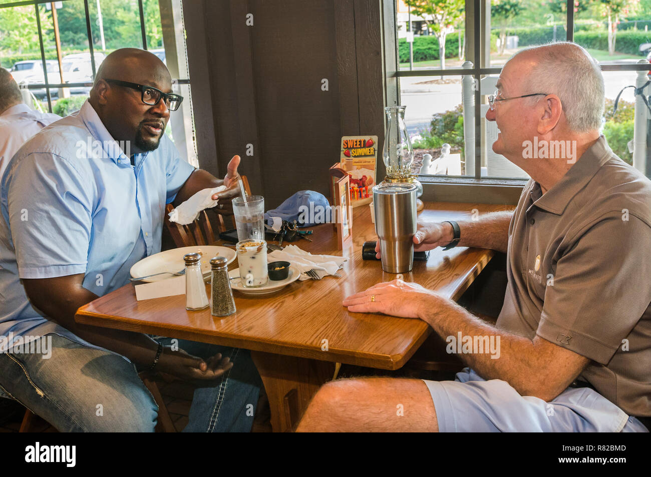 Birmingham pastors Alton Hardy and Bob Flayhart talk over breakfast in Birmingham, Alabama. The two are working to improve race relations in the city. - Stock Image