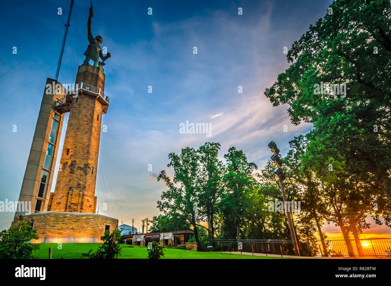 The sun sets at Vulcan Park, July 19, 2015, in Birmingham, Alabama. The park features an iron statue of the Roman God, Vulcan. Stock Photo