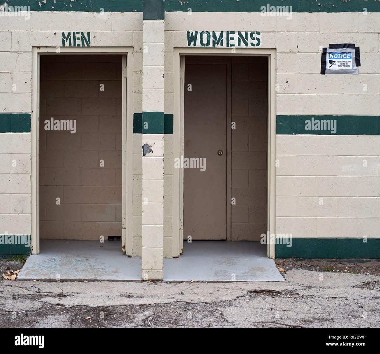 Misspelled public toilets in Alpine, Texas - Stock Image