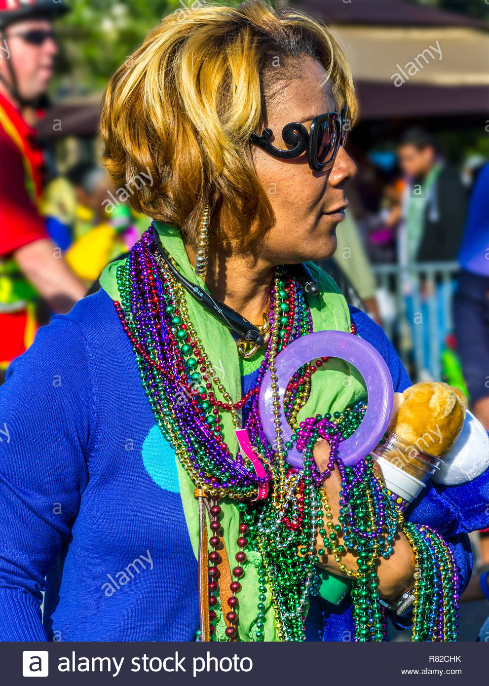 A parade goer carries loot she gathered during the Joe Cain Procession at Mardi Gras, March 2, 2014 in Mobile, Ala. French settlers held the first Mar - Stock Image