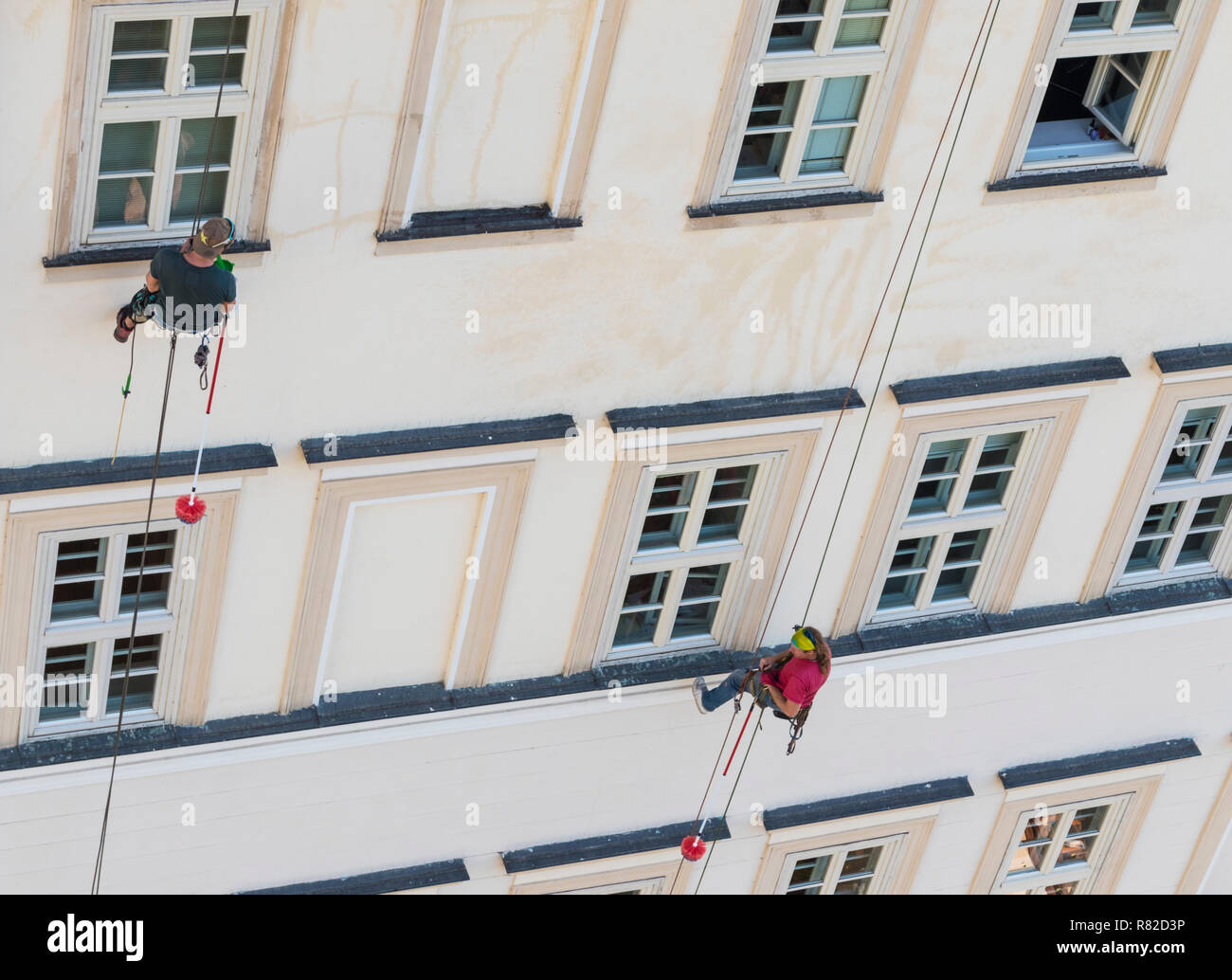 high rise window cleaners abseiling window cleaners working abseiling window cleaning Stock Photo