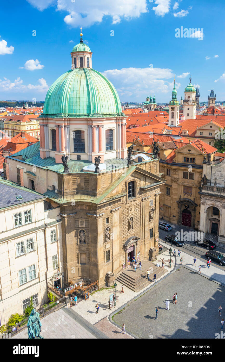 Prague old town Staré Město St. Francis Of Assissi Church Rooftop spires and towers of churches and old baroque buildings Prague Czech Republic - Stock Image