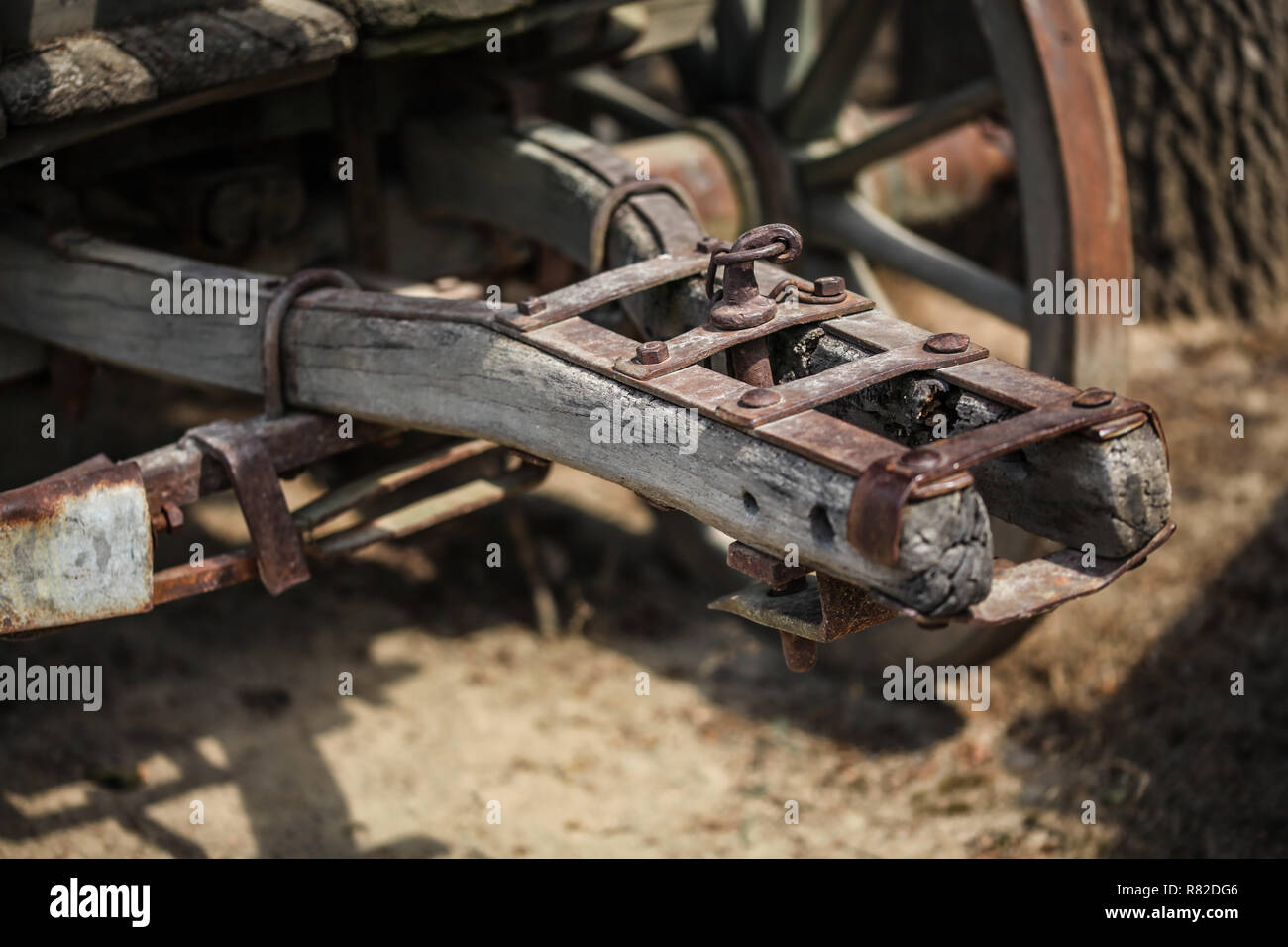 Detail on old rusty wooden wagon connecting mechanism. Stock Photo