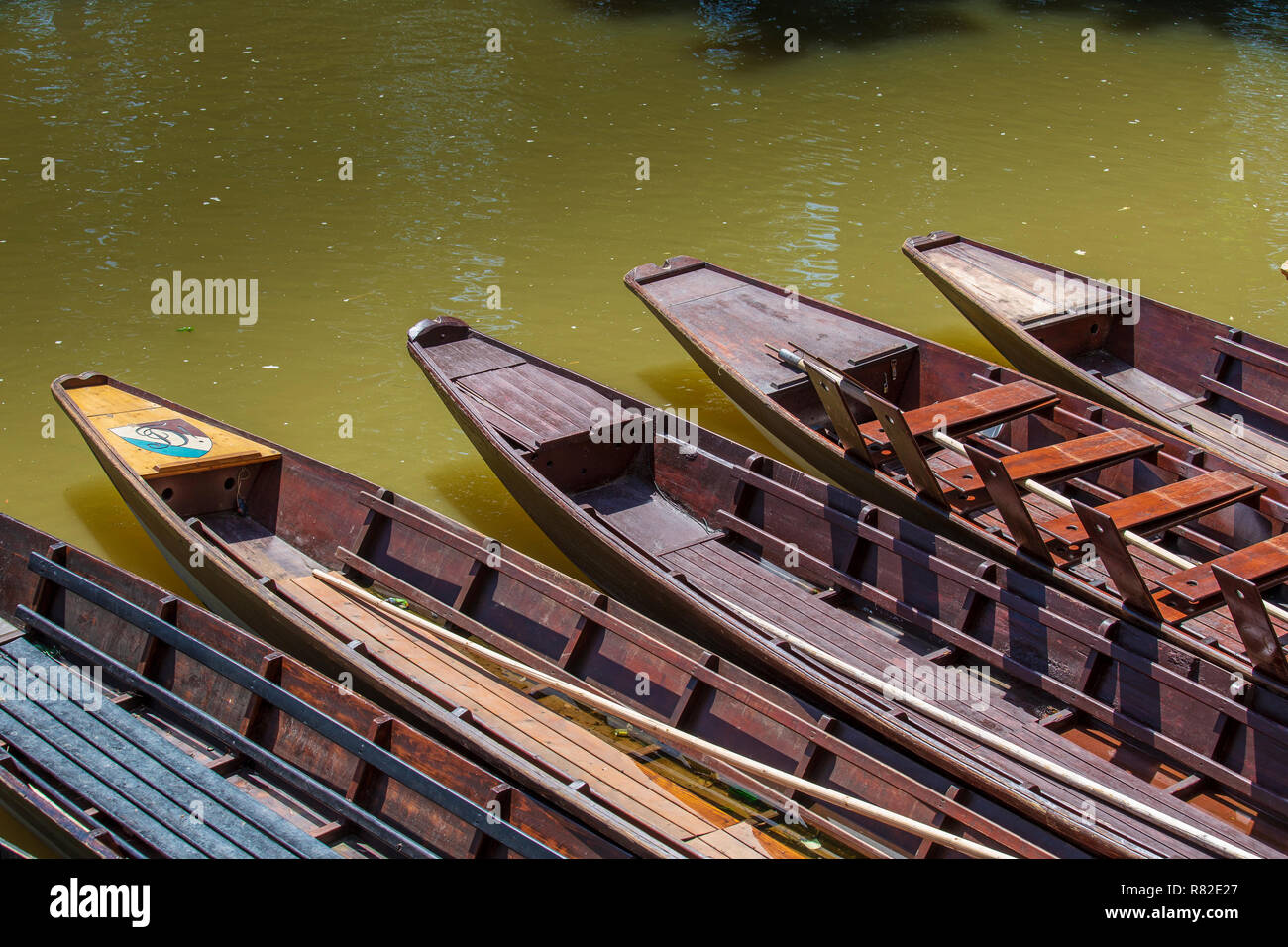 A punt is a flat-bottomed boat with a square-cut bow, designed for use in small rivers or other shallow water - Stock Image