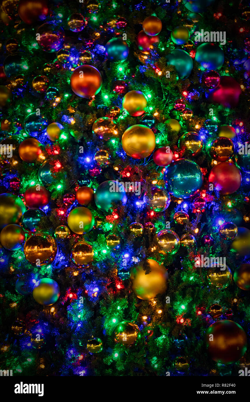 A Christmas tree decorated with ornaments and lights for the