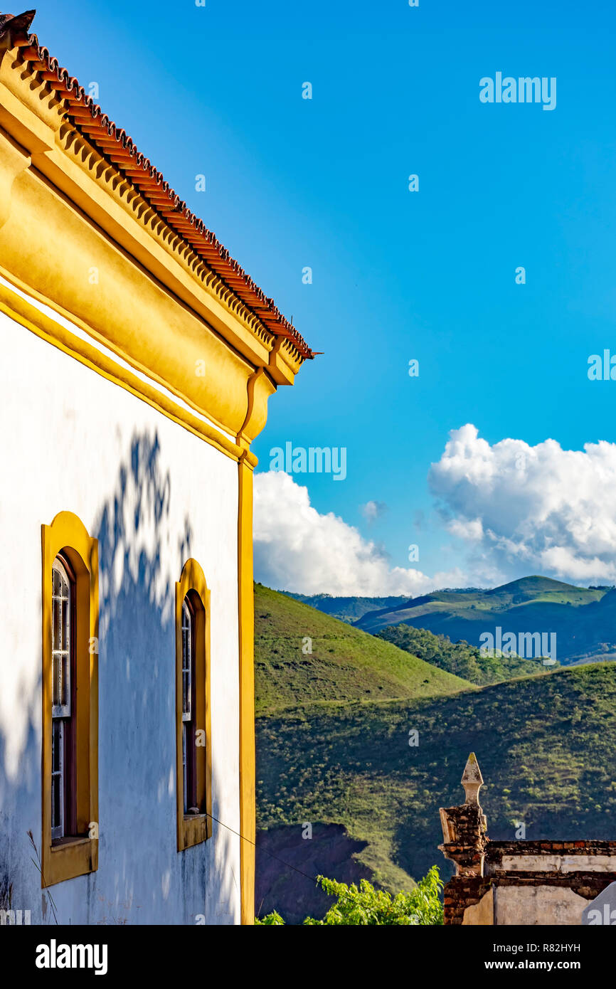 Side view of old catholic church of the 18th century with hills and horizon of the famous and historical city of Ouro Preto in Minas Gerais - Stock Image
