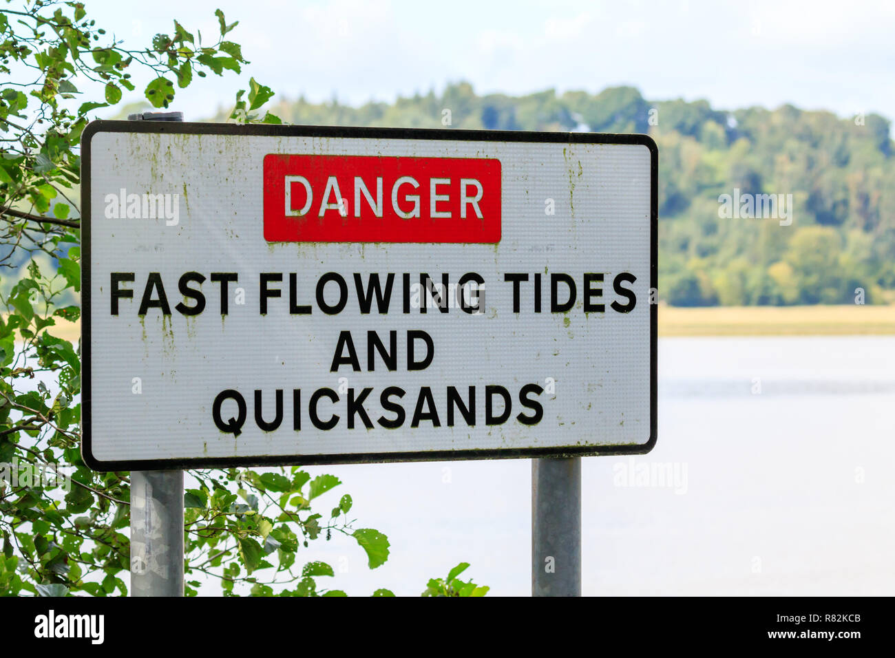 Danger Fast Flowing Tides and Quicksands sign Stock Photo