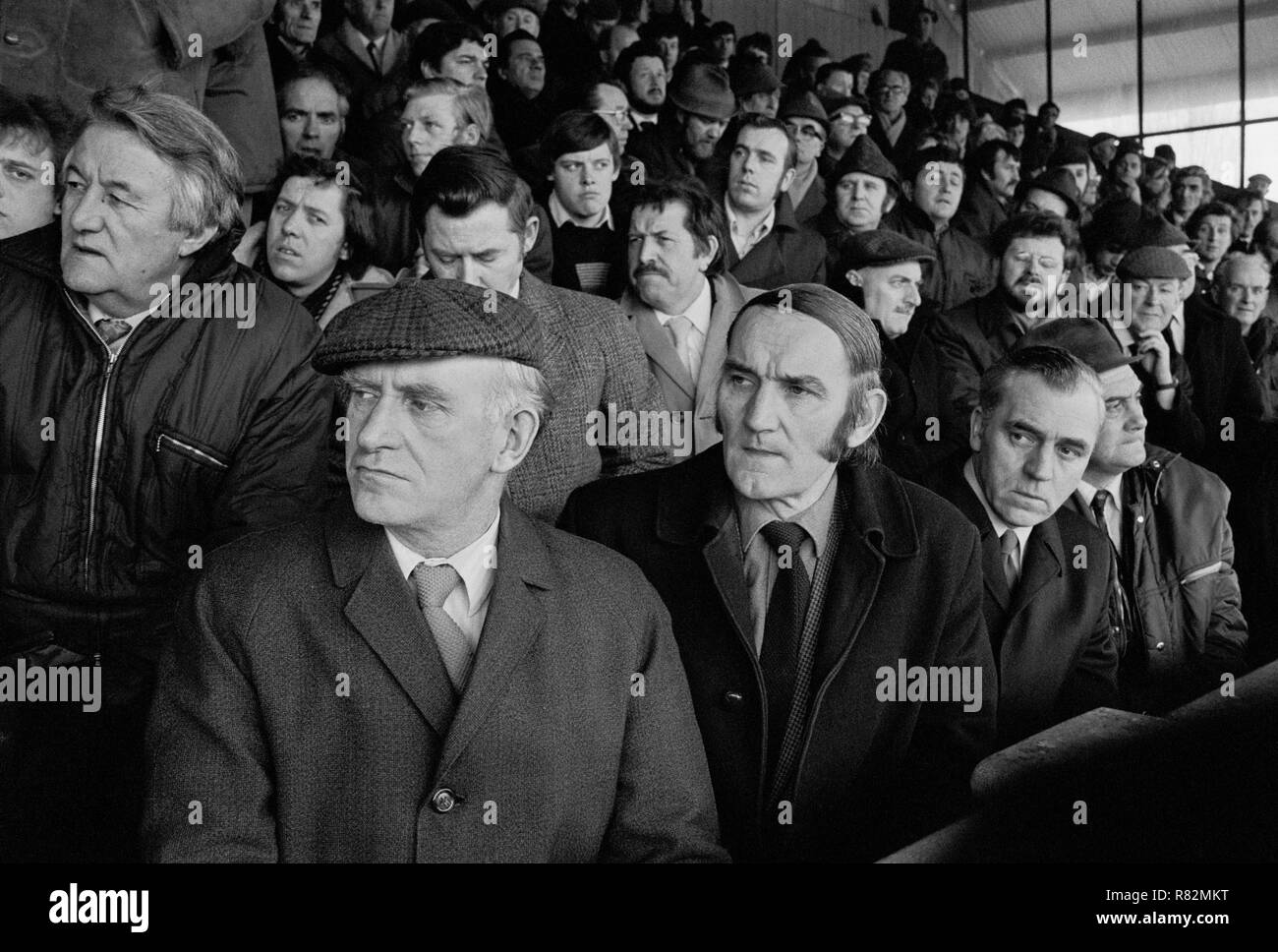 Shocked steelworkers are told that their plant is to be closed, Ebbw Vale Welfare Ground, South Wales, 1975 - Stock Image