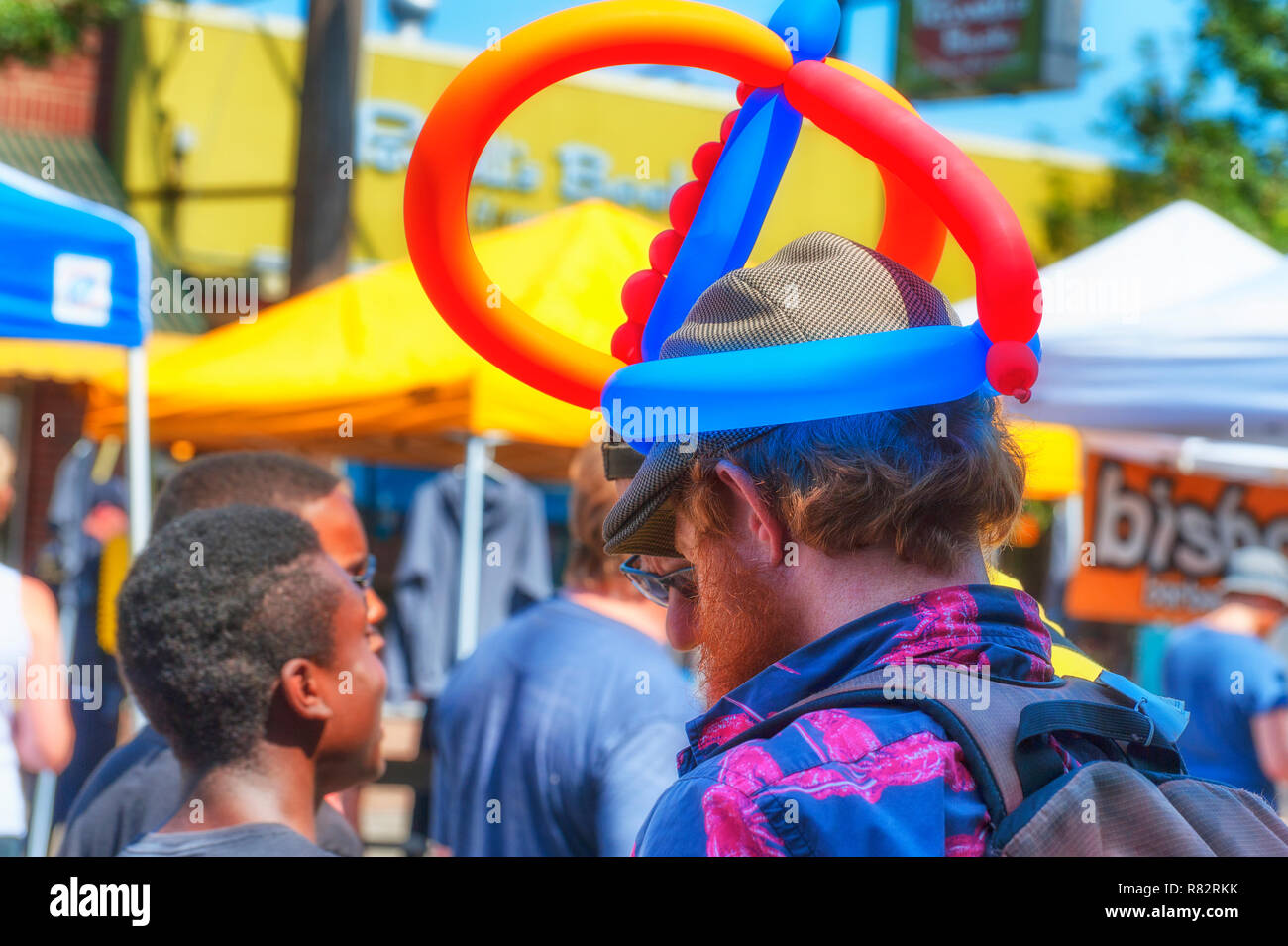 Portland, Oregon,USA - August 17,2014:  Hawthorn Street annual Community Event. Close up of a man wearing a balloon hat. - Stock Image