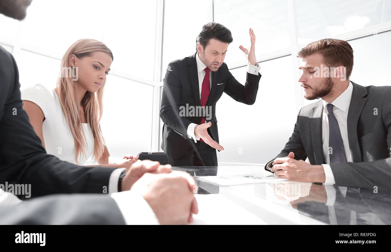 angry businessman at a working meeting with the business team - Stock Image