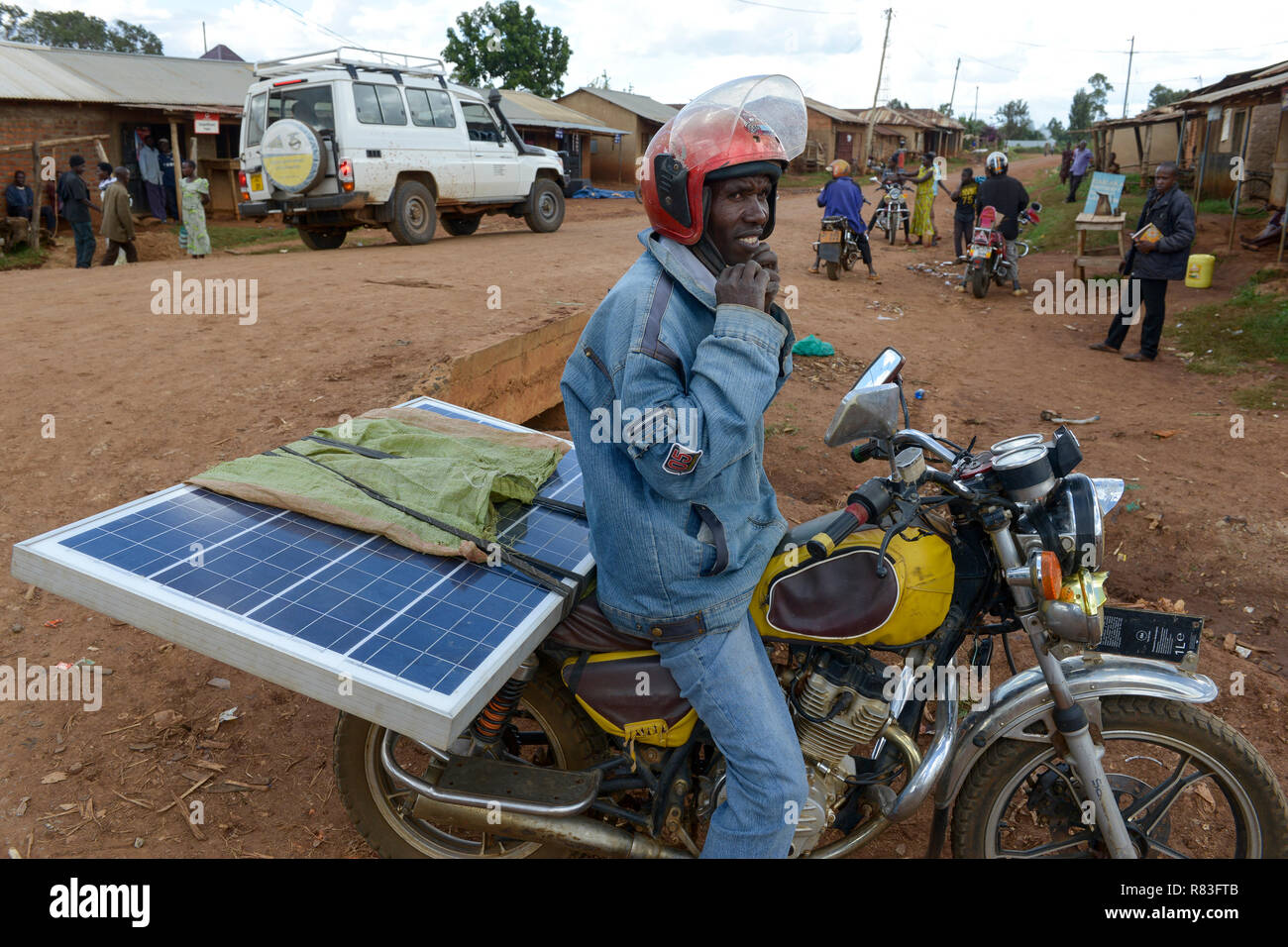 TANZANIA, Tarime, transport of PV solar panel by motorbike / Transport eines Solar Panels mit dem Motorrad - Stock Image