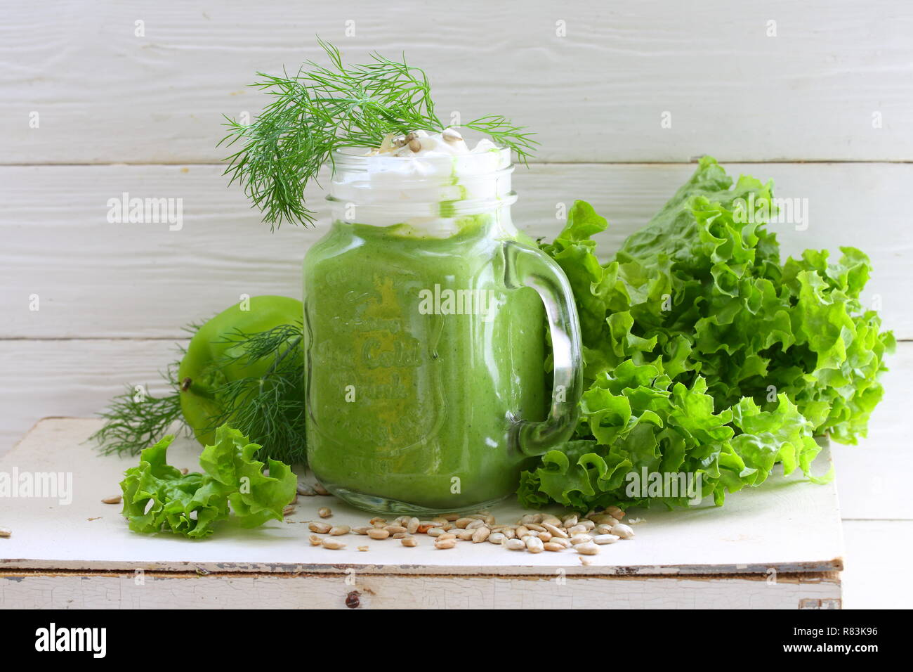 Green smoothie with kiwi, spinach, cucumber and orange Stock Photo