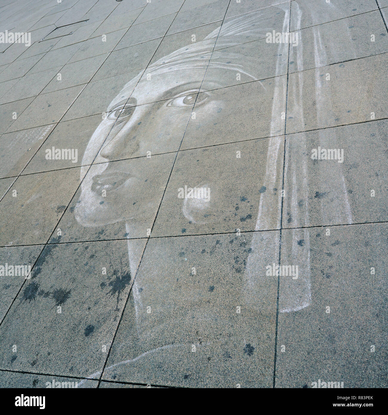 faded chalk drawing on a footpath in Berlin - Stock Image