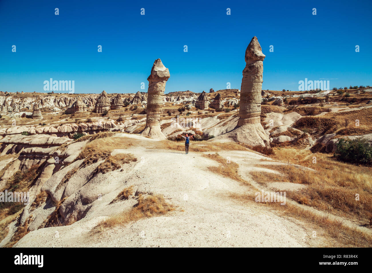 Tourist girl in central Turkey. The unearthly landscape of Cappadocia. - Stock Image