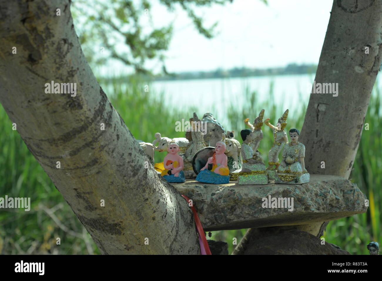 Figurines in a tree, pasakdek - Stock Image
