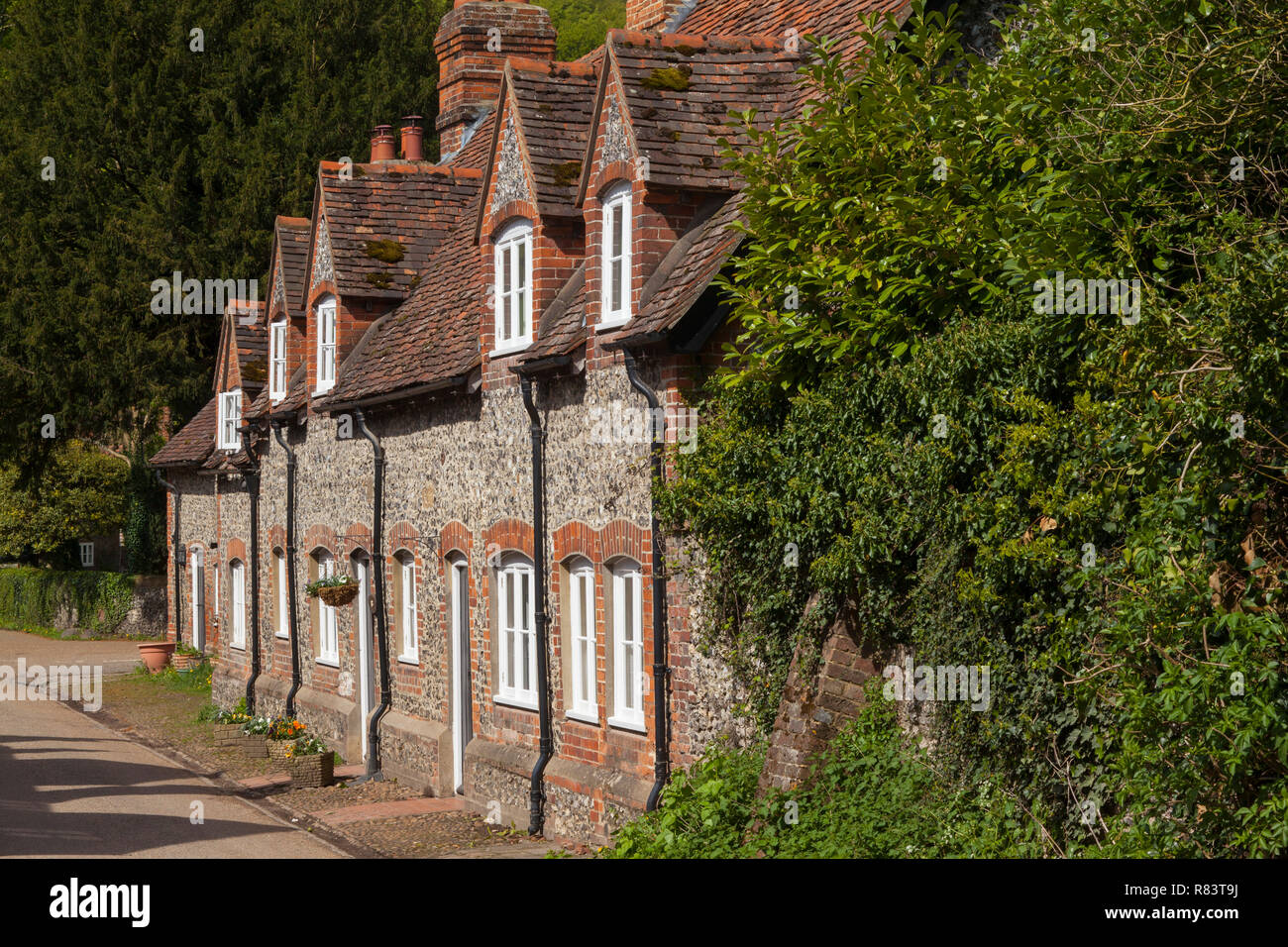 A row of traditional brick and flint cottages in the village of Hambleden, Buckinghamshire Stock Photo