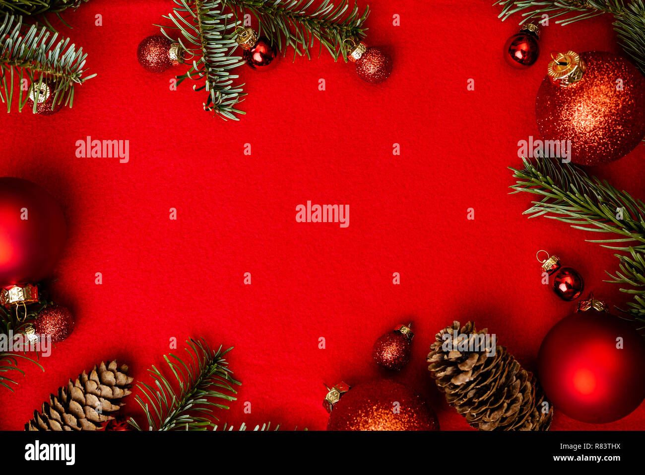 Christmas red background with fir tree, red christmass balls frame